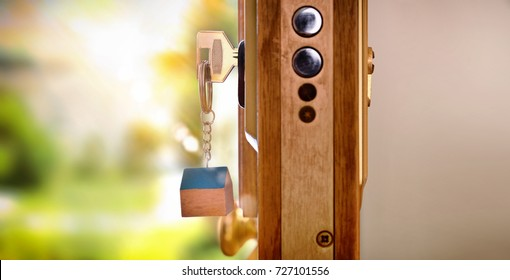 Door section with keys in the lock with exterior and interior detail. Concept of security and purchase of housing. Lateral view
