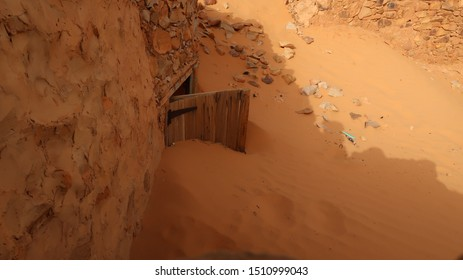 A door that was taken over by the desert and fully covered in sand in the old town of Chinguetti in Mauritania