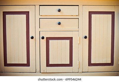 The door of a vintage kitchen cabinet close-up. Front view. Space for text.