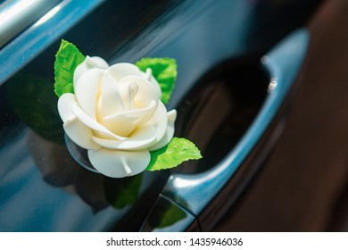 Door of wedding car with flower and pearls