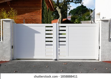door white new metal driveway entrance gates portal in modern suburb house