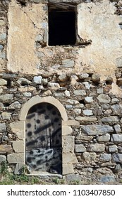 Door and window of old ruined house on the Crete island, Greece