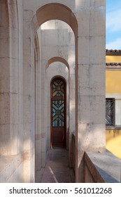 The door with the window on the balcony with the arches in the main building of the Italian Victorial, the open-air museum in lake Garda