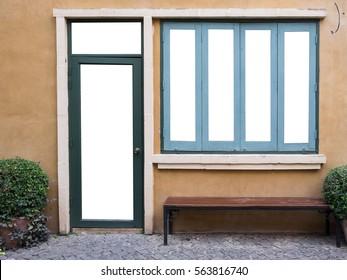 Door, windows,  bench on brown wall.