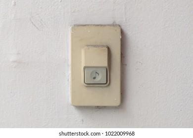 doorbell or buzzer on gray wall