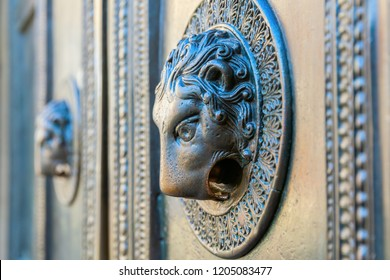doorknob of the portal of the famous Aachen Cathedral in Aachen, Germany. It is known for having the devils finger inside of the doorknob