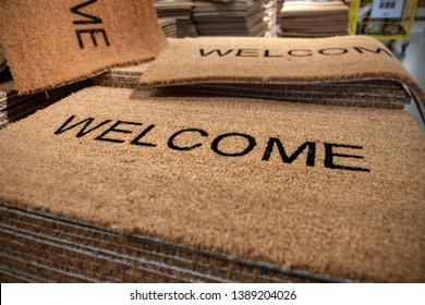 Doormat with inscription WELCOME, at display in store