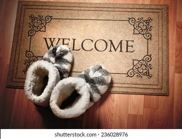 Doormat with text Welcome. Cleaning foot carpet with shoes made of sheep wool