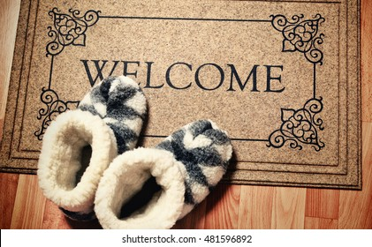 """Doormat in vintage style with inscription """"Welcome"""". Cleaning foot carpet with shoes made of sheep wool"""