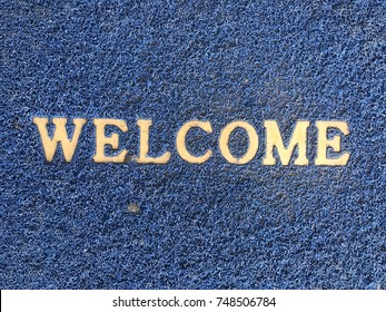 doormat of welcome text surface.