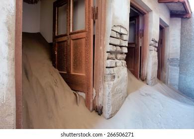 Doors of abandoned house in sand. Shot in Kolmanskop ghost town, Namibia.