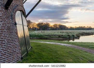 Doors of a corn mill with a view on a reconstructed river landscape in April - Hunze, The Netherlands.