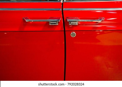 Doors of red retro car.
