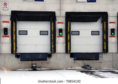 Doors for unloading goods from transport trucks