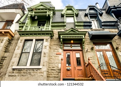 Doors, windows and cornices full-color houses typical of Montreal.