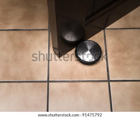 Merveilleux Doorstop Holding Door On Ceramic Floor