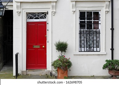Doorway entrance to house in London with red door