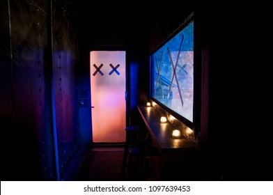 the doorway in neon light with the x sign on the door