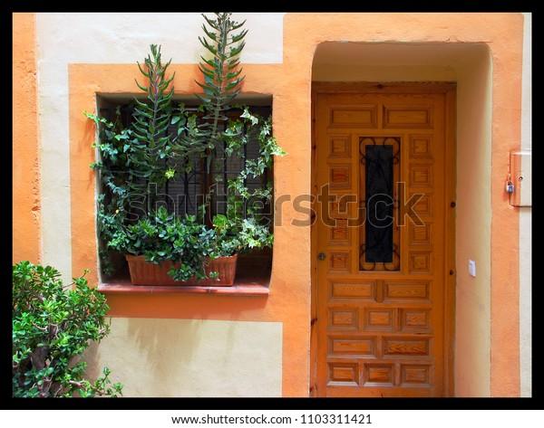 doorway and planters on windowsill