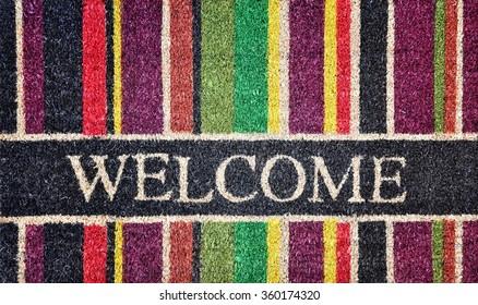 Doorway rug or doormat, welcome, natural fibers, background, toned image