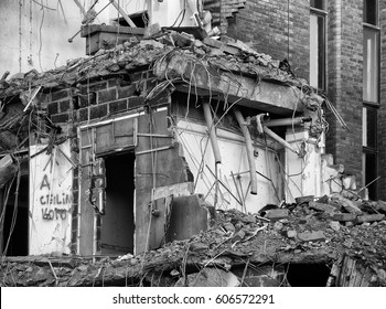 doorway showing through rubble in a demolished building