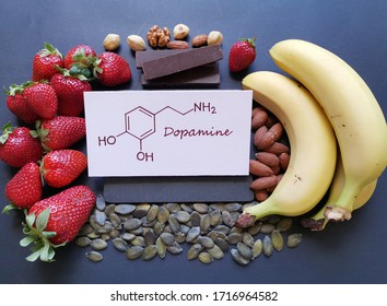 Dopamine-boosting foods. Assortment of food for good mood and happiness. Healthful foods that may help boost dopamine. Natural sources of dopamine with structural chemical formula of hormone dopamine.