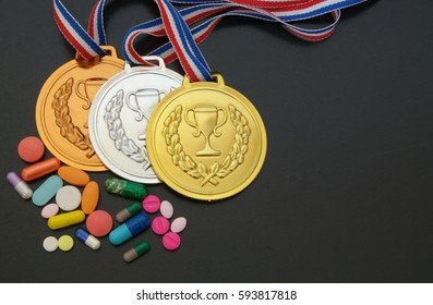 Doping in sport concept. Drugs and medals on black background.