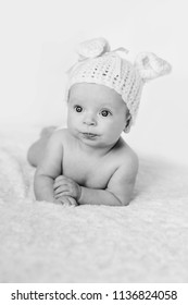 dorable baby girl wearing knitted hat with ears