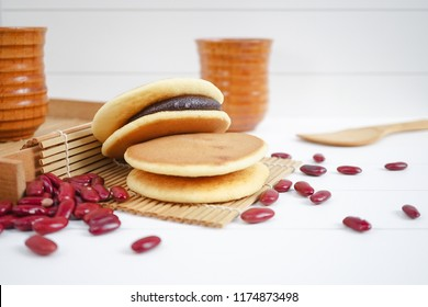 Dorayaki japanese snack. Dorayaki is a japanese bread, japanese pancakes with red beans paste inside, on the white wooden background.