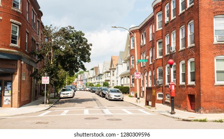 DORCHESTER, BOSTON - OCTOBER 7, 2018: Busy streets with multi family housing in Savin Hill, Boston near the red line stop on the T.
