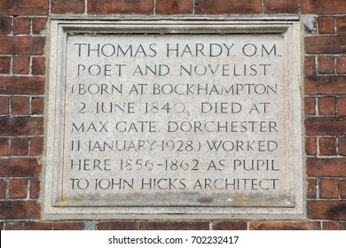DORCHESTER, UK - AUGUST 15TH 2017: A plaque marking the location where Poet and Novelist Thomas Hardy once worked, on South Street in Dorchester, Dorset, on 15th August 2017.