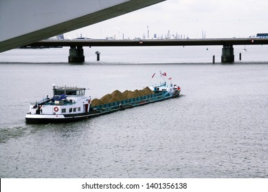 Dordrech/Holland; 04/30/2016. Cargo ship crossing under the Moerdijk bridges in the Netherlands are bridges that connect the Island of Dordrecht with the Dutch province of North Brabant.