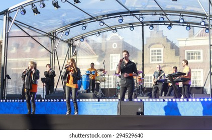 DORDRECHT, THE NETHERLANDS - APRIL 27, 2015: Musical entertainment during the visit of the Dutch royal family on Hollands national Kings day celebrations in the old center of Dordrecht.