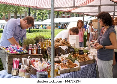 DORDRECHT, NETHERLANDS - JUNE 30, 2013: Unidentified sellers and shoppers at the Swan Market in Dordrecht, on June 30 2013. The lifestyle market was originally started in vacant shops in the Zaagmolenstraat, Rotterdam
