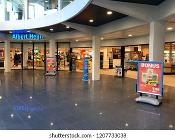 Dordrecht, the Netherlands - October 20, 2018:  Grocery shop entrance Albert Heijn Dordrecht. Albert Heijn or AH, is the largest supermarket chain in the Netherlands.