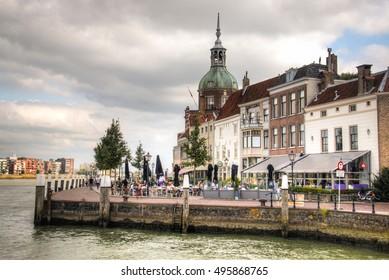 DORDRECHT, NETHERLANDS - OCTOBER 2016: View over the Maas river in Dordrecht, Netherlands with restaurants on the riverside