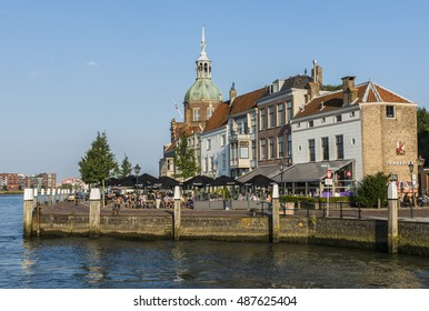 Dordrecht, The Netherlands - September 13, 2016: Terrace in Dordrecht with Groothoofdspoort and water of the Merwede in Zuid-Holland, The Netherlands.