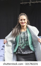 DORDRECHT, NETHERLANDS - SEPTEMBER 27 2015: Free entertainment fashion show in the main square organized by the municipality. Model in green outfit on the catwalk showcasing the new winter collection.