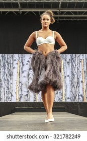 DORDRECHT, NETHERLANDS - SEPTEMBER 27 2015: Free entertainment and fashion show in the main square organized by the municipality. Model in lingerie on the catwalk showcasing the new winter collection.