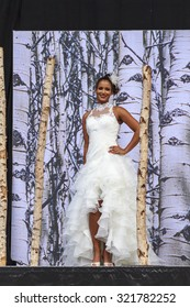 DORDRECHT, NETHERLANDS - SEPTEMBER 27 2015: Free entertainment fashion show in the main square organized by the municipality. Model bride in wedding dress on the catwalk showcasing the new collection.