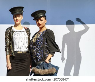 DORDRECHT, NETHERLANDS - SEPTEMBER 29 2013: Free entertainment and fashion show in the main square organized by the municipality. Two models standing on the catwalk showcasing the new collection.