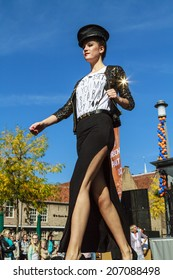 DORDRECHT, NETHERLANDS - SEPTEMBER 29 2013: Free entertainment and fashion show in the main square organized by the municipality. Model with star walking on the catwalk showcasing the new collection.