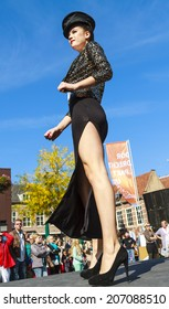 DORDRECHT, NETHERLANDS - SEPTEMBER 29 2013: Free entertainment and fashion show in the main square organized by the municipality. Model in split skirt on the catwalk showcasing the new collection.
