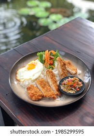 Dori katsu donburi served on a plate. Dori katsu donburi is Japanese food in the form of white rice with dory fish on top