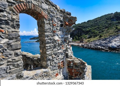 Doria Castle and the Church of St. Peter, San Pietro sit above the Ligurian village of Porto Venere ( Portovenere), Italy.  This coastal Italian village is the gateway to Cinque Terre.