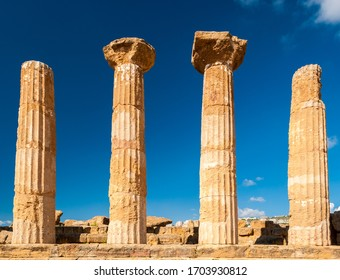 Doric columns of the Heracles temple in Agrigento with blue sky in background (Sicily, Italy)
