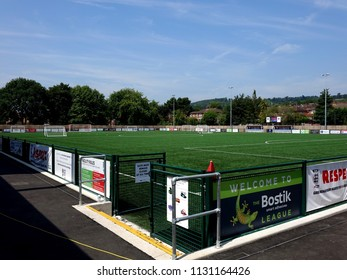 Dorking, Surrey, UK- JULY 6 2018: The New Dorking Wanderers Football Stadium, Showing the Astro Turfed Pitch with Surrounding Sponsor Banners.