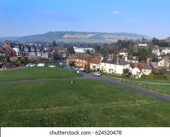 DORKING, SURREY, UK- MARCH 18, 2017:  Box Hill, highest summit of north downs (background) Cotmandene, Dorking in the foreground. Picturesque market town south of London on sunny spring day.