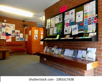Dorking, Surrey, United Kingdom - May 1st, 2018: The National Health Service, Showing a Doctors Waiting Room with Health Related Leaflets on a Display Board with Seating Surrounding the Central column