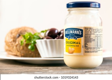 DORKOVO, BULGARIA - FEBRUARY 07, 2018: Jar of Hellmann's Mayonnaise in front of sandwich on red country-style tablecloth. Hellmann's Mayonnaise has been sold publicly since 1905